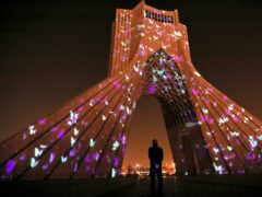 The video mapping is projected on Tehran's Azadi (freedom) tower to commemorate 176 victims of the Ukrainian flight during a municipal memorial marking the first anniversary (Ebrahim Noroozi/AP)