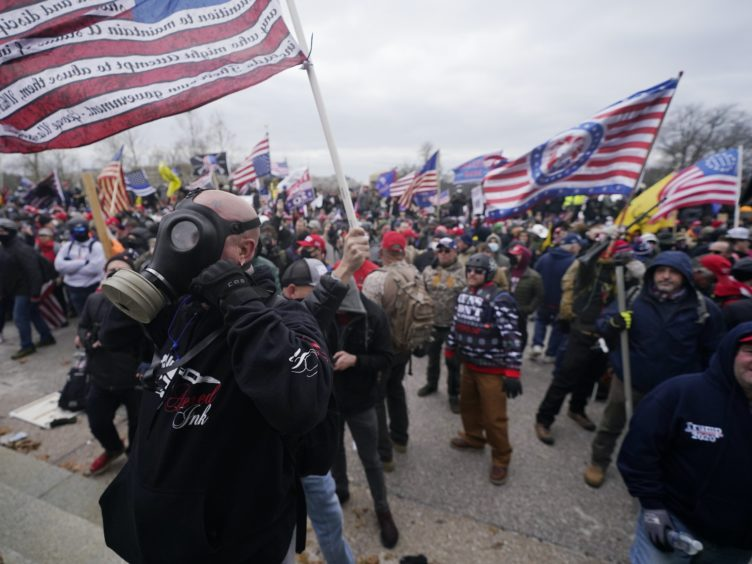 Trump supporters gather outside the Capitol (Julio Cortez/AP)