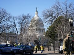 Workers install no-scale fencing around the US Capitol in Washington (Evan Vucci/AP)