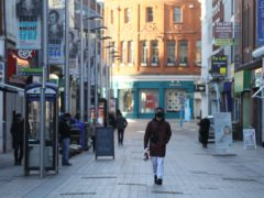 A man walks down a quiet street in Belfast city centre (Brian Lawless/PA)