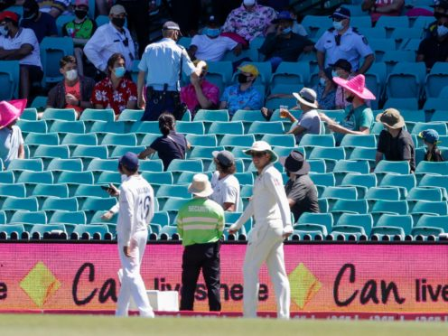 Police, top, remove spectators from the game during play on day four of the third Test between India and Australia at the SCG (AP/Rick Rycroft).