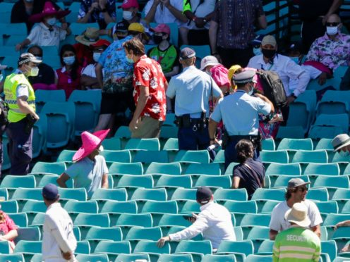 Police escort spectators from the stands during play on day four of the third Test between India and Australia at the SCG (AP/Rick Rycroft)