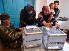 People vote during the presidential elections in Kyrgyzstan (Vladimir Voronin/AP)