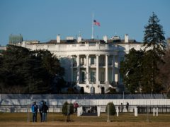An American flag flies at half-mast above the White House (Patrick Semansky/AP)