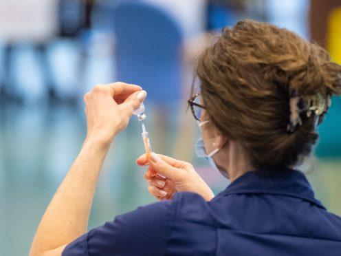 A nurse prepares a dose of the Oxford/AstraZeneca Covid-19 vaccine (PA)