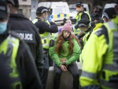 A protester is surrounded by police during a Scotland Against Lockdown protest outside the Scottish Parliament in Edinburgh (Jane Barlow/PA)