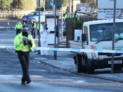 Police officers in forensic suits at the scene of the incident (Andrew Milligan/PA)