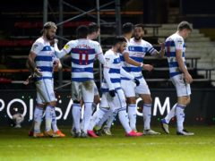 Charlie Austin, left, celebrates scoring QPR's first goal (Zac Goodwin/PA)