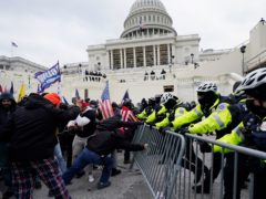 Trump supporters try to break through a police barrier at the Capitol in Washington (Julio Cortez/AP)