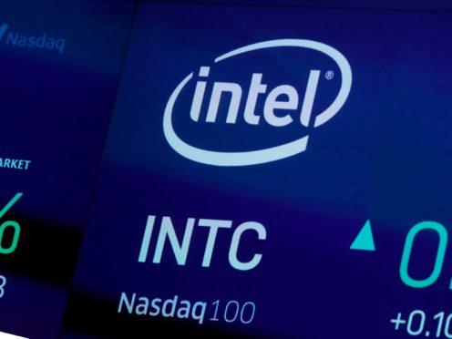 The symbol for Intel appears on a screen at the Nasdaq MarketSite, in New York (Richard Drew/AP)