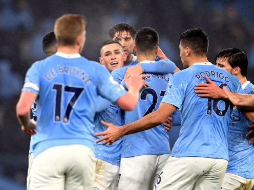 Manchester City players celebrate Phil Foden's goal against Brighton on Wednesday night, despite warnings for players to avoid hugging (Laurence Griffiths/PA)