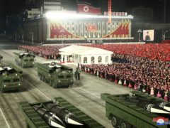 """In this photo provided by the North Korean government, missiles are seen on truck a military parade marking the ruling party congress, at Kim Il Sung Square in Pyongyang, North Korea Thursday, Jan. 14, 2021. Independent journalists were not given access to cover the event depicted in this image distributed by the North Korean government. The content of this image is as provided and cannot be independently verified. Korean language watermark on image as provided by source reads: """"KCNA"""" which is the abbreviation for Korean Central News Agency. (Korean Central News Agency/Korea News Service via AP)"""