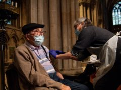 Peter Whatson, 91, receives an injection of the Oxford/AstraZeneca coronavirus vaccine at Lichfield Cathedral, Staffordshire (Jacob King/PA)