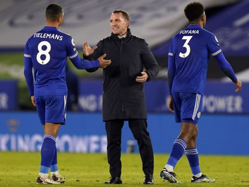 Brendan Rodgers (centre) congratulates his players after their win over Chelsea (Tim Keeton/PA)