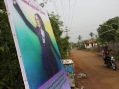 A banner featuring U.S. Vice President-elect Kamala Harris with a message wishing her the best is displayed in Thulasendrapuram, the hometown of Ms Harris' maternal grandfather, south of Chennai, Tamil Nadu state, India (Aijaz Rahi/AP)