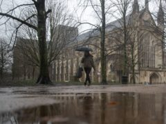 A person walks through the grounds of Winchester Cathedral in Winchester, Hampshire (Andrew Matthews/PA)
