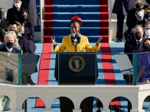 US National Youth Poet Laureate Amanda Gorman reads at Joe Biden's inauguration (Patrick Semansky/AP)