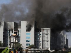 Firemen try to douse a fire at the Serum Institute of India, the world's largest vaccine maker, in Pune (Rafiq Maqbool/AP)