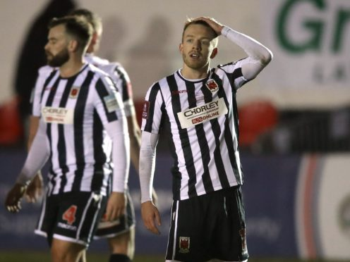 Chorley's brilliant FA Cup run ended in a battling defeat to Wolves (Martin Rickett/PA)