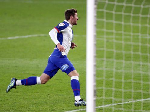 Joe Rothwell celebrates scoring his side's first goal (Richard Sellers/PA)
