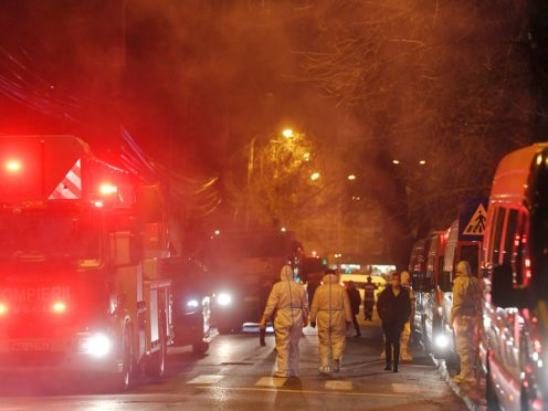 Emergency paramedics and firefighters outside a hospital after a fire broke out on the ground floor (AP)
