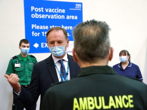 Sir Simon Stevens talks to a member of the vaccine team during a visit to the Centre for Life in Newcastle (Owen Humphreys/PA)