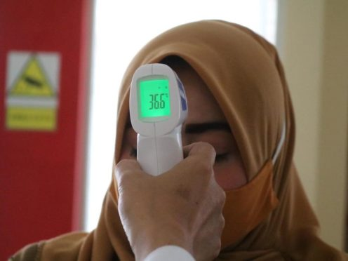 Scientists have warned that body temperature scanners provide a large number of false negative results (Mufid Majnun/ Unsplash/PA)