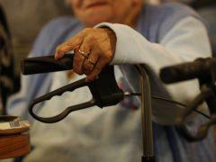 An elderly woman with her walker (Jonathan Brady/PA)