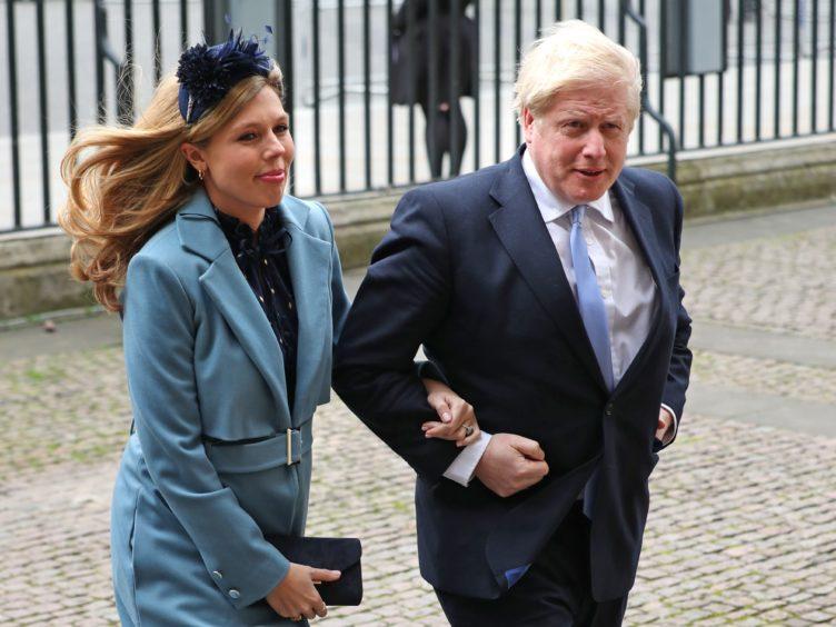 Prime Minister Boris Johnson and partner Carrie Symonds (Yui Mok/PA)