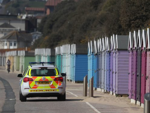 Police officers patrol the sea front at Bournemouth beach (Andrew Matthews/PA)