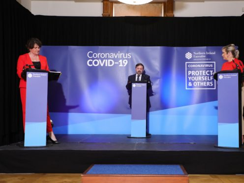 First Minister Arlene Foster, Health Minister Robin Swann and deputy First Minister Michelle O'Neill (Kelvin Boyes/Press Eye/PA)