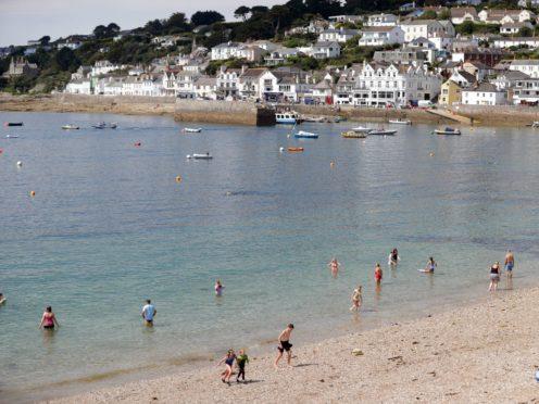 People on the beach at St Mawes, Cornwall (David Davies/PA)
