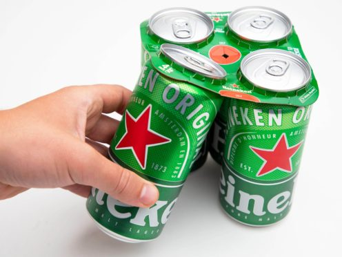 A four pack of Heineken beer featuring the new 100% plastic-free cardboard topper, which has been developed by the drinks brand to eliminate the use of plastic rings that have traditionally held cans together (PA)
