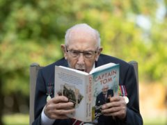 Captain Sir Tom Moore with his autobiography (Joe Giddens/PA)