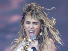An emotional Miley Cyrus fought back tears during her star-studded pre-Super Bowl performance (Aaron Chown/PA)