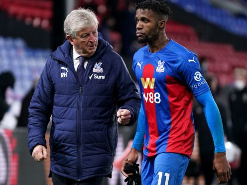 Crystal Palace manager Roy Hodgson, left, is eager for the return of Wilfried Zaha (John Walton/PA)