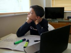 Euan Stanton, a year 7 pupil at a secondary school in Ashford, Kent, studies at home (PA)