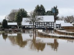 The Rose and Crown pub in Severn Stoke is cut off by floods (David Davies/PA)
