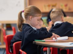 EMBARGOED TO 0001 MONDAY FEBRUARY 1 File photo dated 02/09/20 of children in class at Arbours Primary Academy in Northampton. School closures could lead to a loss in earnings of �350 billion in the long run, a report has warned.