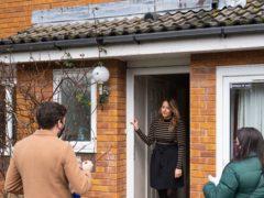 Volunteers speak to residents while carrying out door-to-door coronavirus testing in Woking (Dominic Lipinski/PA)