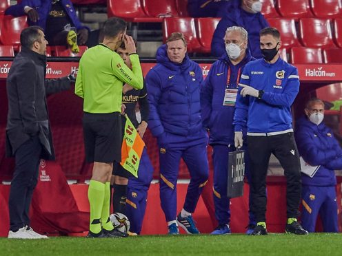 Ronald Koeman was left frustrated as his Barcelona side were beaten 2-0 by Sevilla (AP)