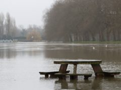 A flooded river bank next to the River Thames in Datchet in Berkshire. Picture date: Thursday February 4, 2021.