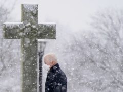President Joe Biden departs after attending Mass at St Joseph on the Brandywine Catholic Church in Wilmington, Delaware as snow falls (Patrick Semansky/AP)