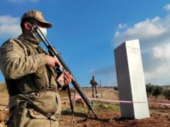 Turkish police officers guarding the monolith (Bekir Seyhanli/IHA via AP)