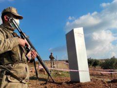 Turkish police officers guard a monolith found in a field (Bekir Seyhanli/IHA via AP)