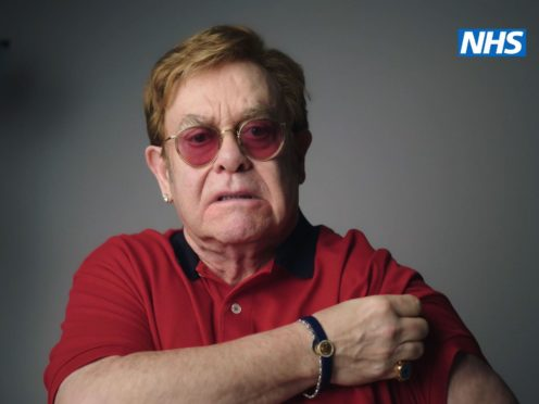 Sir Elton John as he stars, with Sir Michael Caine, in the new video to encourage people to get vaccinated against coronavirus (NHS England/PA)