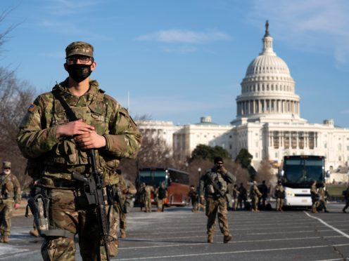 Members of the national guard patrol outside the US Capitol (Jose Luis Magana/AP)