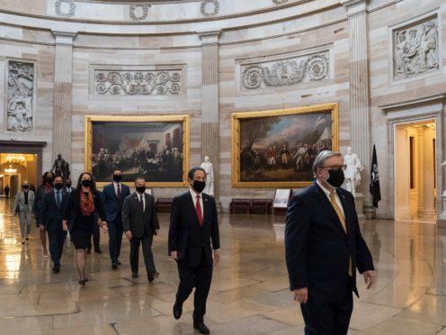 Impeachment managers walk through the Rotunda to the Senate for the impeachment trial (Alex Brandon/AP)