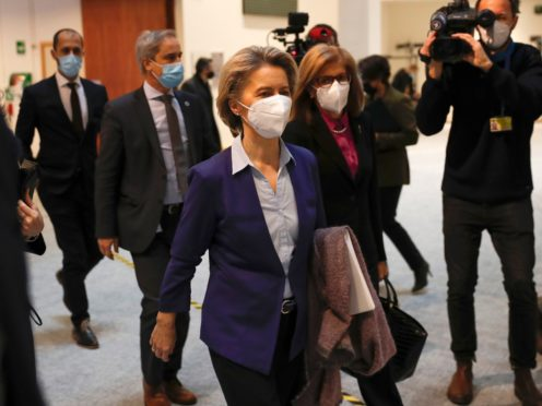 European Commission president Ursula von der Leyen, centre left, arrives for a debate on the EU approach to Covid-19 vaccinations at the European Parliament in Brussels (Francisco Seco/AP)