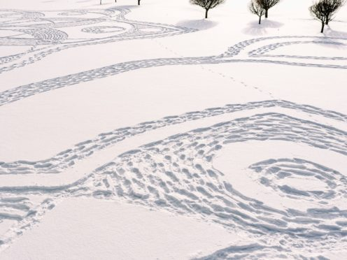 Part of a giant geometric pattern formed from thousands of footsteps in the snow in Finland (Pekka Lintusaari via AP)
